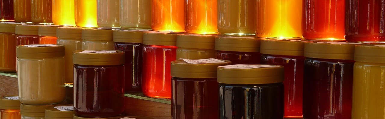 Jars of different colors of honey